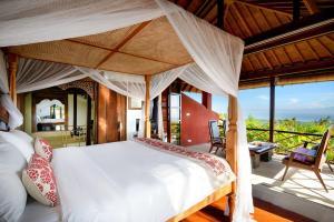 A bed or beds in a room at Canang Sari Villas