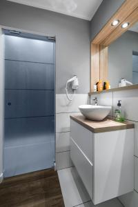 A bathroom at Executive Suites MODUO