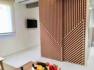 Una televisión o centro de entretenimiento en Inside Bilbao Apartments