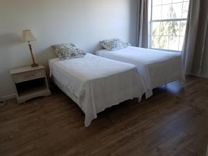 A bed or beds in a room at Green Valley Home