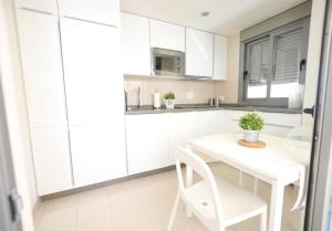 A kitchen or kitchenette at Sitito Good Life Apartment