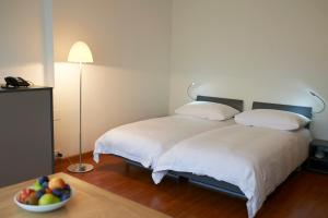 A bed or beds in a room at Congress Apartments by Hotel du Commerce