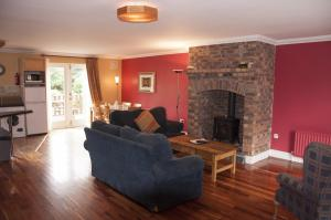 A seating area at Courtyard Holiday Cottages