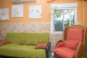 A seating area at Lightbooking- Book and sunbed