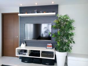 A television and/or entertainment center at Sally's Place at Eastwood Le Grand 3