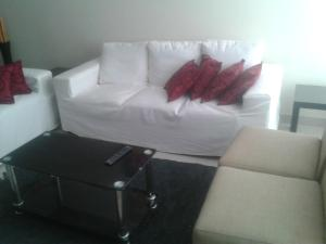 A bed or beds in a room at Los Eucaliptos Ica Peru