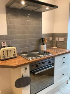 A kitchen or kitchenette at Boutique Garden Lodge @ The Larches