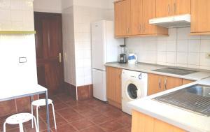 A kitchen or kitchenette at Médano Beachfront Jaquita