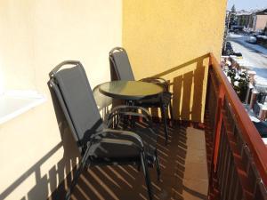 A balcony or terrace at Apartmánový dom Eliška