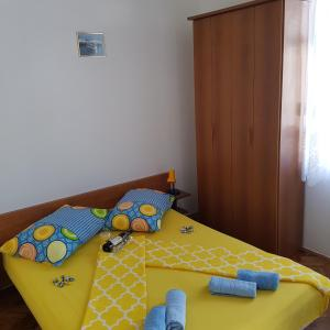 A bed or beds in a room at Dubrovnik Apartman
