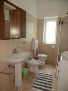 Ein Badezimmer in der Unterkunft La Casa Gialla