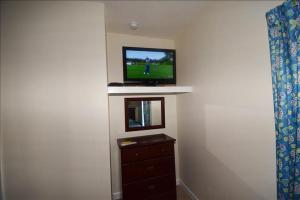 A television and/or entertainment center at 822 Cypress Bend Villa