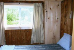A bed or beds in a room at Wickiup