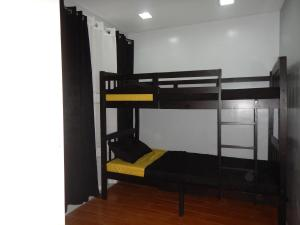 A bunk bed or bunk beds in a room at Alta Cielo in The Courtyards Baguio