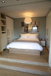 A bed or beds in a room at Navarinou Loft Apartment