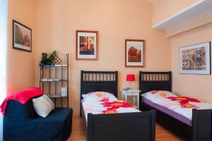 Ein Bett oder Betten in einem Zimmer der Unterkunft Mozart