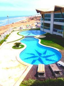 A view of the pool at Canoa Quebrada Luxury Residence or nearby