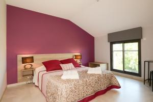 Un ou plusieurs lits dans un hébergement de l'établissement Gite La Pétillante