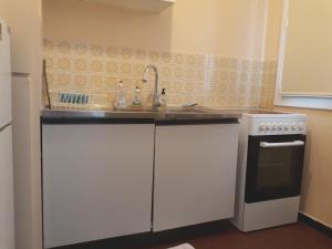 A kitchen or kitchenette at Studio À Dijon