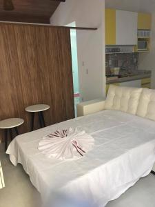 A bed or beds in a room at Luxuoso Apartamento no Solar Agua
