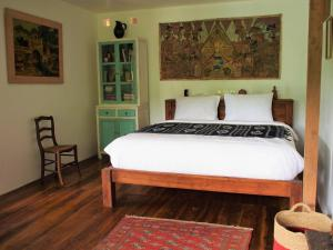 A bed or beds in a room at Villa Loti