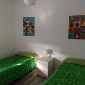 A bed or beds in a room at Bungalow Parte Alta