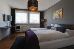 A bed or beds in a room at Boardinghouse Mundsburg