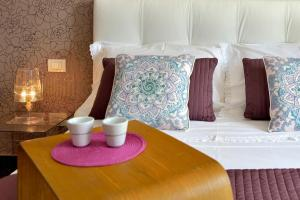 A bed or beds in a room at VILLA RELAX & COMFORT POZZALLO