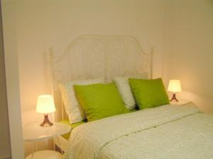 A bed or beds in a room at Fira Barcelona View Montjuic Apartments
