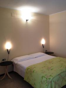 A bed or beds in a room at La Fattoria Apartments