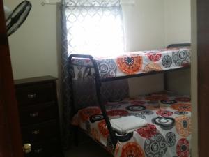 A bunk bed or bunk beds in a room at Apartamento Acuario Nacional