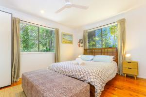 A bed or beds in a room at Fingal Beach House