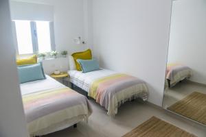 A bed or beds in a room at Moderna vivienda en Las Canteras