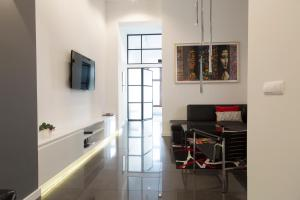 A television and/or entertainment center at Art Room Boutique Apartment
