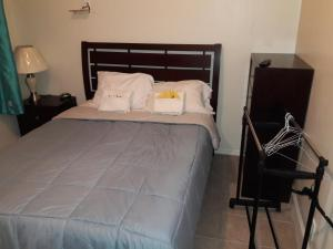 A bed or beds in a room at Studio and 1 Bedroom Apartments - Bronx