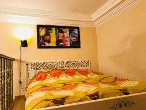 Кровать или кровати в номере Maia's Apartment