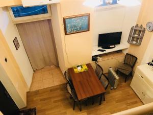 Телевизор и/или развлекательный центр в Maia's Apartment