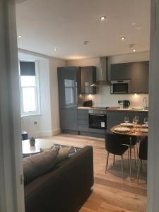 A kitchen or kitchenette at Brighton Lanes Boutique Beach Apartment