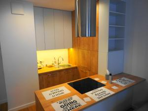 A kitchen or kitchenette at Magazynowa Airport Apartments