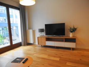 A television and/or entertainment center at Magazynowa Airport Apartments