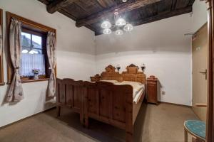 A bed or beds in a room at Chata Barborka