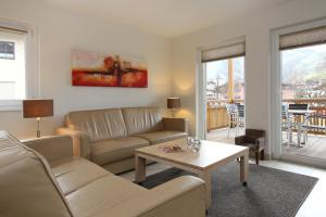 A seating area at Avenida Style Appartements by Alpin Rentals