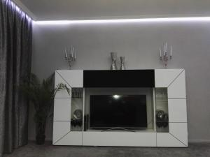 Télévision ou salle de divertissement dans l'établissement Apartment Villa Ksenija