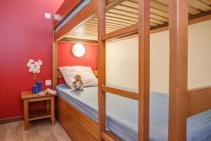 Un ou plusieurs lits superposés dans un hébergement de l'établissement Résidence Pierre & Vacances Les Trois Domaines