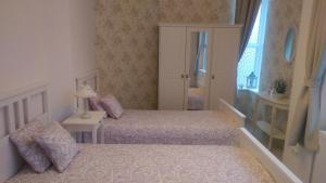 A bed or beds in a room at Romantic Style Apartment Berlin Mitte