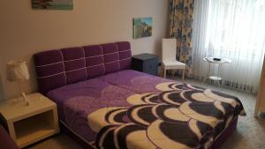 A bed or beds in a room at Centrum Apartments - I. P. Pavlova
