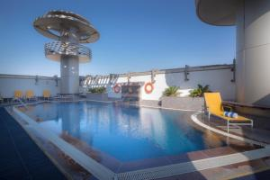 The swimming pool at or near Vision Hotel Apartments Deluxe