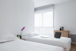 Un ou plusieurs lits dans un hébergement de l'établissement Annemasse Apparts