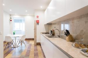 A kitchen or kitchenette at Cruz Apartments