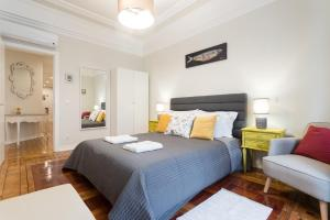 A bed or beds in a room at Cruz Apartments